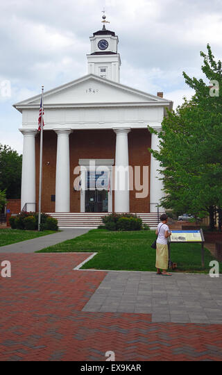 Woman stops to read the sign in front of the Old Court House civil war museum on the Old Town Mall, Winchester, - Stock Image