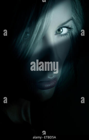 Serious young woman staring - Stock-Bilder