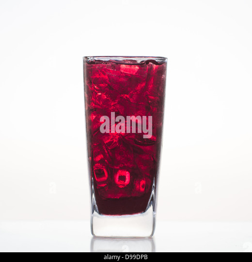sweet-grape-juice-with-ice-in-glass-isol