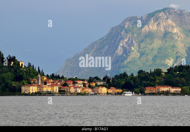 A landscape scene taken from the lake approaching this lovely Italian town Bellagio on the shores of Lake Como in - Stock Image