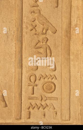 Egypt Kom Ombo temple reliefs hieroglyphs ankh falcon horus figures people  hieroglyphic symbols - Stock Image