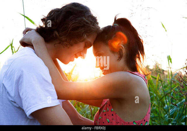 Young couple embracing, touching foreheads - Stock-Bilder