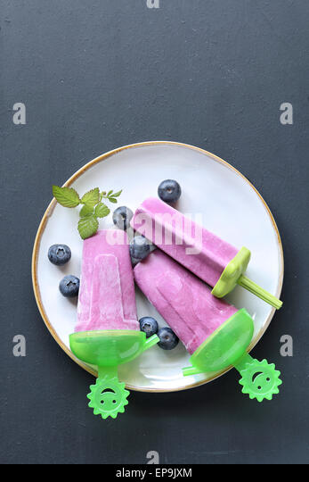 Blueberry popsicle ice lollipop - Stock Image