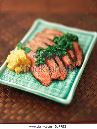 Sliced Steak with Plantain Chutney and Green Chili Cilantro - Stock Image