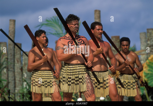 Maori men from New Zealand perform a war dance using weapons at the 6th Festival of Pacific Arts on Rarotonga Cook - Stock Image