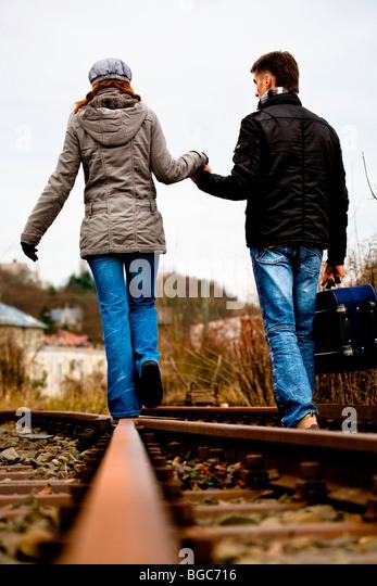 Couple on rail track - Stock Image