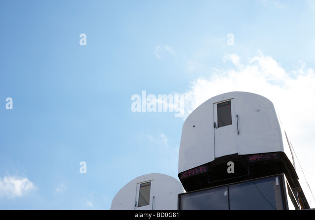 Tube carriages, balanced on top of a building - Stock Image