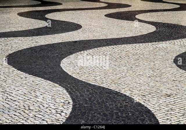 Wavy lines in mosaic paving stones in the Largo do Senado, the Senate Square in Macau, China. - Stock Image