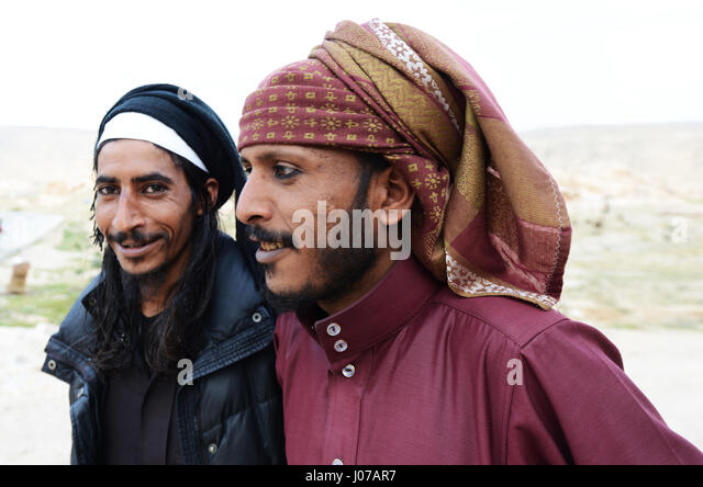 Young Bedouin men wearing a traditional eyeliner called Kohel. - Stock Image