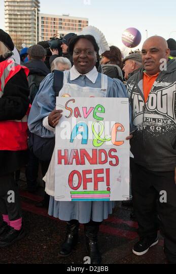 London UK. 26th January 2013. . Woman wearing nurses uniform holding placard reading A&E Hands off preparing - Stock Image