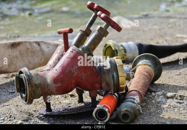 Fire Fighting Equipment Fire Hose Nozzles Valve - Sabang, Puerto Galera, Oriental Mindoro, Philippines, Southeast - Stock Image