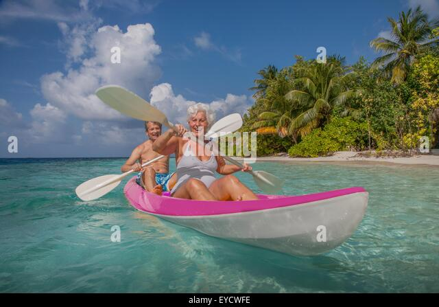 Senior couple in canoe, Maldives - Stock Image