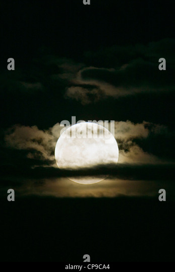 Perigree full moon, or supermoon, rises over Salida, Colorado, USA. Moon is closer to earth in orbit than normal. - Stock Image