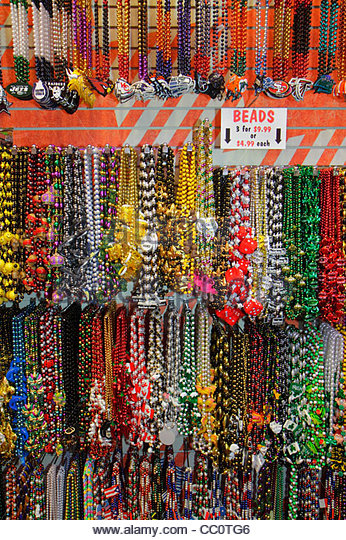 Louisiana New Orleans French Quarter Bourbon Street store business souvenir gift shop shopping beads display colorful - Stock Image