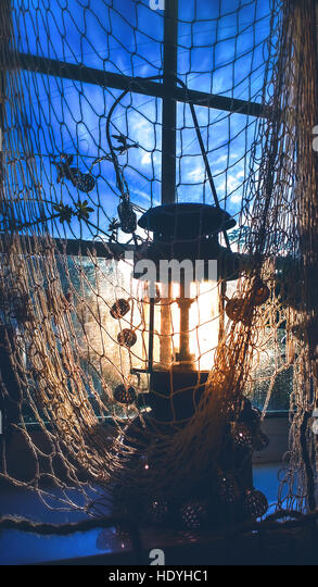fisherman net and old lamp - Stock Image