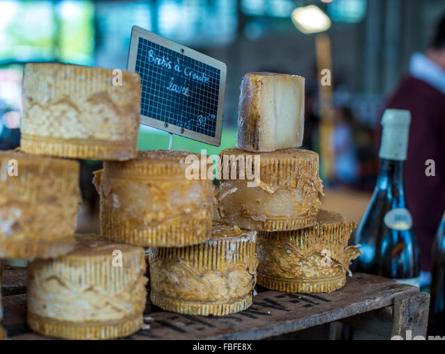 Close-Up Of Cheese Stack On Display At Store - Stock Image