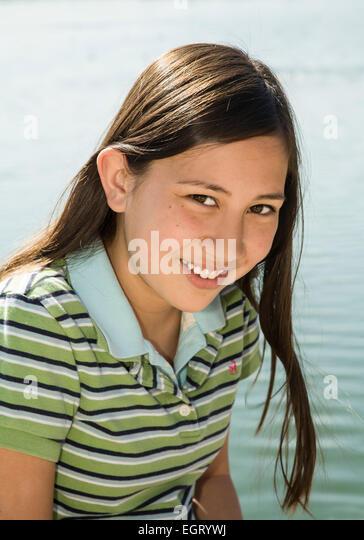 Teen Vietnamese/Caucasian girl outside smiling at camera. MR  © Myrleen Pearson - Stock-Bilder
