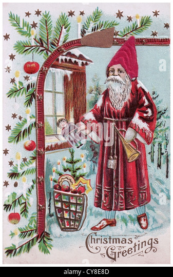 Old Fashioned Santa Claus to front of house - Stock Image