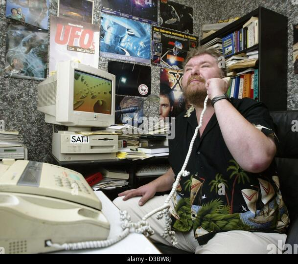 (dpa) - Werner Walter takes a telephone call in his office at the UFO reporting centre in Mannheim, Germany, 26 - Stock Image