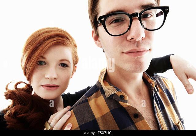 Studio portrait of cool young couple - Stock-Bilder