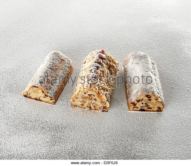 3 selected Stollen marzipan logs cake - Stock Image