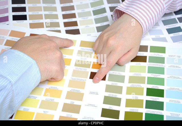 Business people with swatches to decide the color of the office - Stock Image
