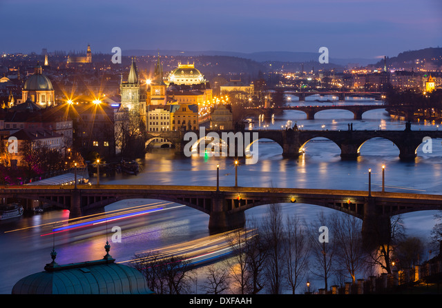 the Manes, Charles and Legion Bridges over the Vltava River at dusk, with the Old Town on the left, Prague, Czech - Stock-Bilder