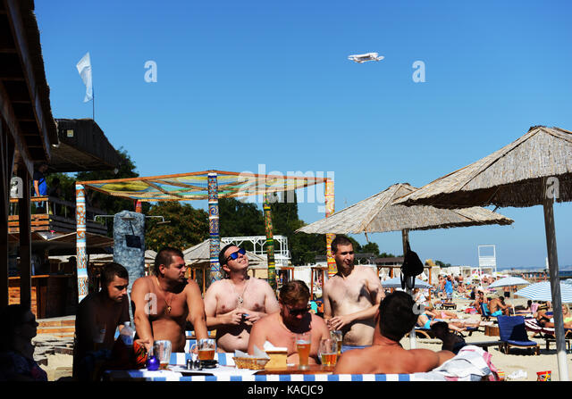 A group of Ukrainian men with their drone at the vibrant Otrada beach in Odessa, Ukraine. - Stock Image