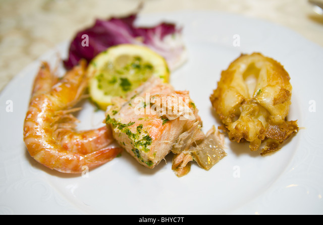 A selection of fried and cooked fish plate appetizer - Stock Image