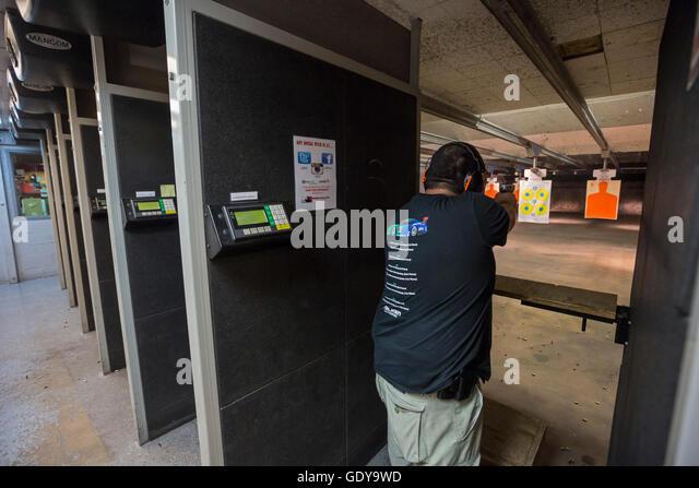 Las Vegas, Nevada - A man fires his handgun at the Discount Firearms + Ammo indoor shooting range. - Stock Image