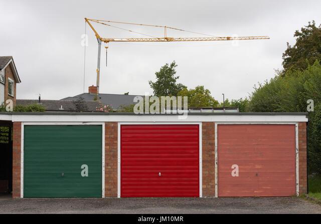 Construction crane behind garage doors - Stock Image