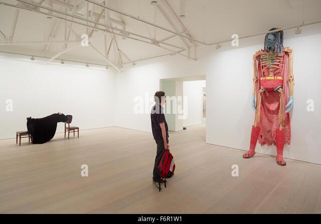 Visitor at art exhibition at the Saatchi Gallery look at 'Beautiful Superman', David Herbert sculpture - Stock Image