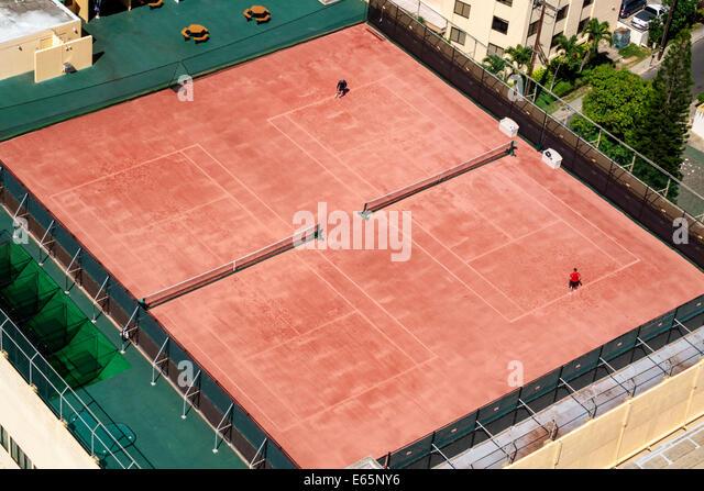 Hawaii Hawaiian Honolulu Waikiki Beach Tennis Club court rooftop - Stock Image
