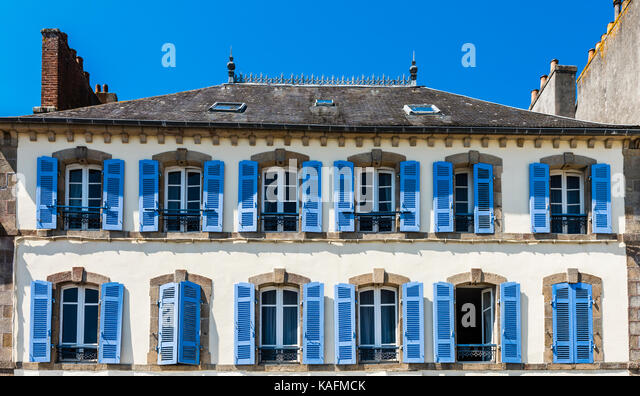 Blue shutters on a building in Brittany, France - Stock Image