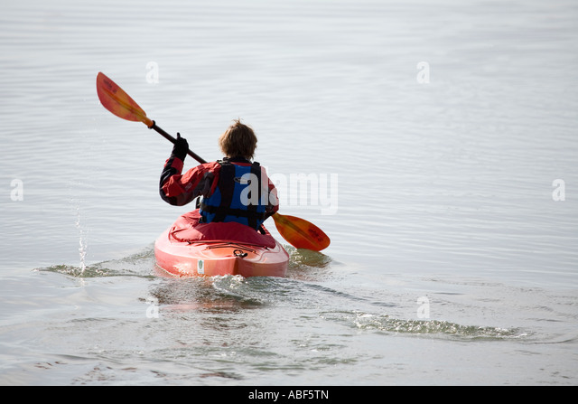 kayaking in the sea in winter, Dell Quay, Chichester, West Sussex, England, UK - Stock Image