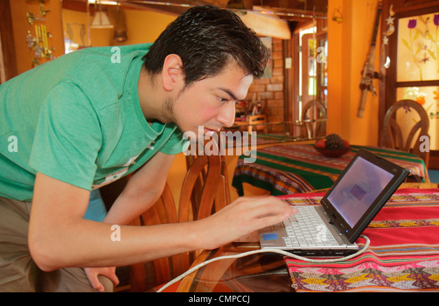 Peru Lima Barranco Avenida D'Osma D'Osma Bed & and Breakfast lodging lobby Hispanic man young adult - Stock Image