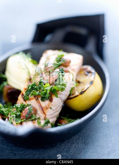 Grilled salmon,almond and butter sauce - Stock Image
