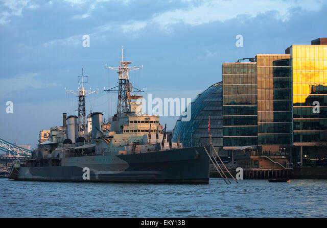 HMS Belfast museum ship Royal Navy light cruiser, moored in London on the River Thames and operated by Imperial - Stock Image
