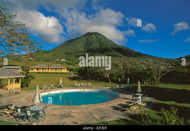 Mount Nevis peak, green volcano crater, open fields, Island of Nevis, St Kitts and Nevis, Caribbean swimming pool - Stock Image