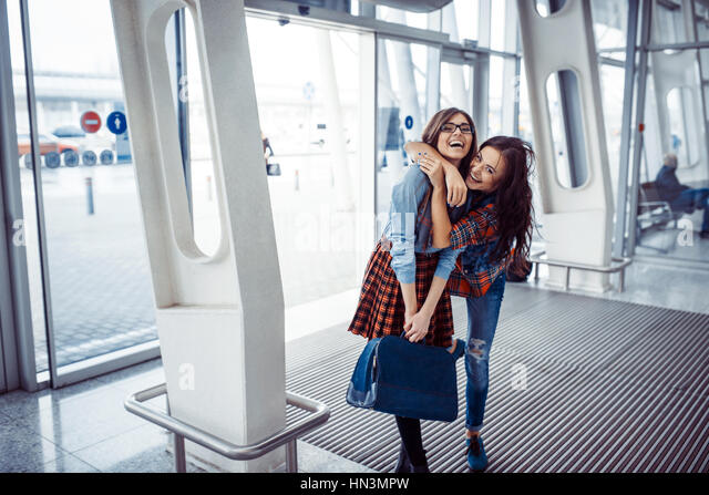 Girls holding hands in a suitcase.Art processing and retouching - Stock Image