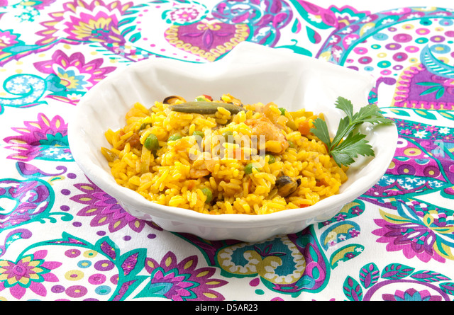 paella-fried spicy rice with chicken, seafood and vegetables - Stock Image