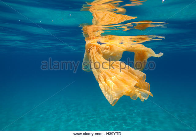 orange dress floating under the water surface - Stock Image