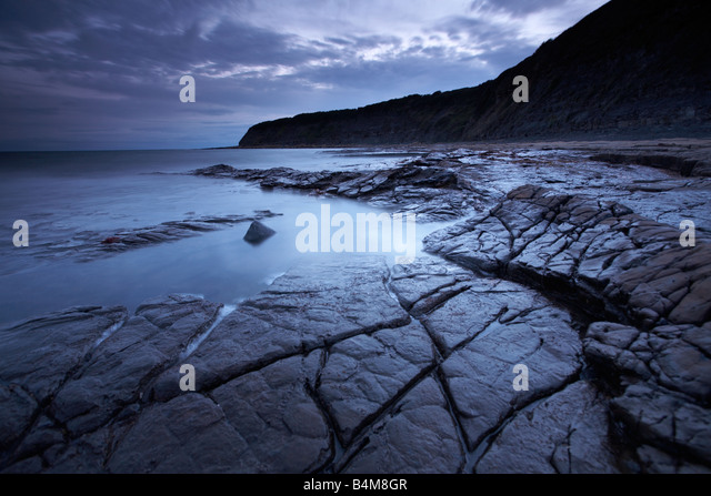 Kimmeridge at dusk in Dorset, England, UK - Stock Image