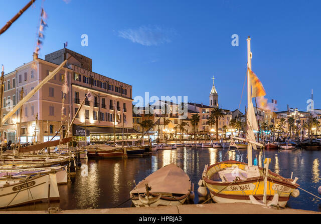 Mediterranean Fishing boats at Sanary-Sur-Mer , twilight, Promenade, Mistral Clouds, French Riviera,  Cote d Azur, - Stock Image