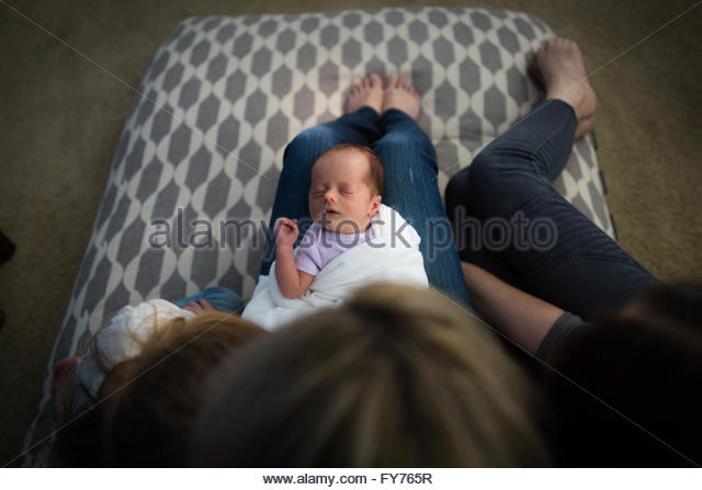 Newborn Baby Girl being Admired by Family - Stock Image
