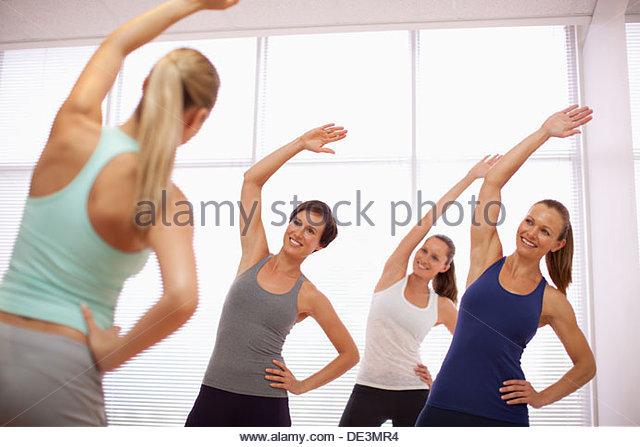 Smiling women in exercise class - Stock-Bilder