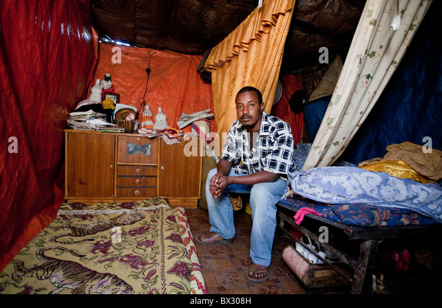 Young man in his humble home in Addis Ababa - Stock Image