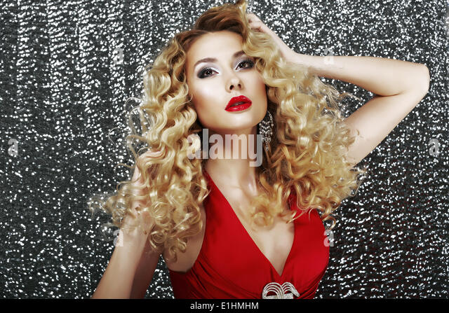 Expression. Glamorous Classy Lady in Red Dress in Reverie. Luxury - Stock Image
