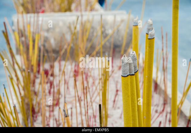 A lot of Incense sticks burning in a receptacle. - Stock Image