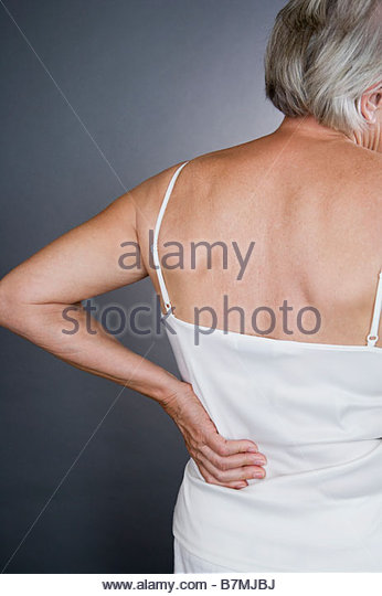 A senior woman with backache - Stock Image